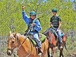 A boy shows his excitement while riding a horse (one of the favorite activities that Reid Ranch offers).