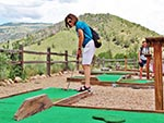A woman prepares to putt.  Putting is the name of the game at the Prairie Dog Greens mini-golf course.
