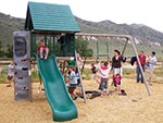 A Children's playground offers activity for the very young.