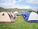These well-organized campers pitched their similar style tents in nice neat rows.