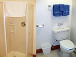Every bedroom in the Tabby Mountain Lodge has its own private bathroom, left shows a shower and right a toilet.