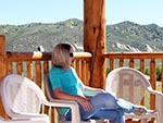 One may enjoy just sitting and thinking in a chair on the lodge deck.