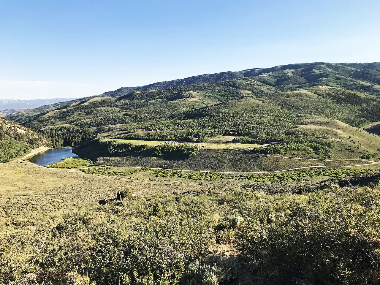 Middle part of a panoramic view of Reid Ranch as seen from the Mountain Hike. The lake is visible to the left with the conference center on the plateau to the right.