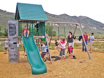 Many children enjoy the activities offered at the playground.