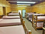 An inside of view of one Dorm in the Bunkhouse, bunk beds line the walls.
